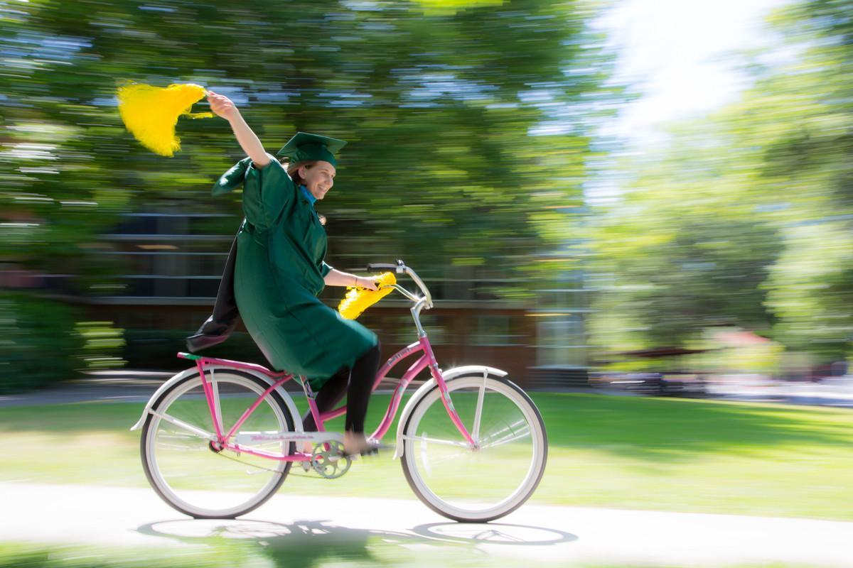 Graduate on bike